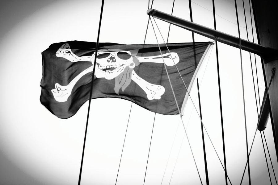 A Pirate's Life I Live ~ I do have 1 leg after all! Pirate Fluttering Nautical Vessel Sky Pirates Flags In The Wind  Flag Wind Outdoors Low Angle View Eyeem Market Eye4photograghy Eyeemphotography Photography Is My Escape From Reality! Perspective From My Point Of View ForTheLoveOfPhotography Sailboat Photography Is My Therapy Monocrome Photography
