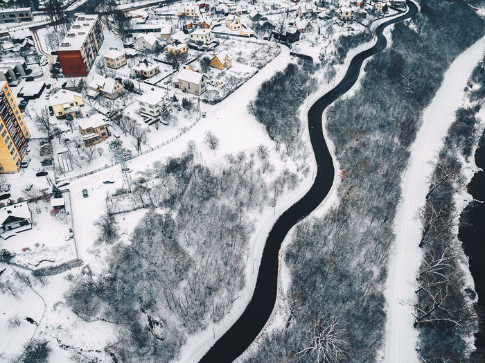 Winding road in winter, aerial view. Lithuania Drone  Lietuva Snowy City Winter Aerial View Beauty In Nature Cold Temperature Coldweather Day Dji Drone Drone Photography Europe High Angle View Landscape Mavic Pro Nature No People Outdoors Scenics Snow Tranquility Weather Winding Road Winter Winter Wonderland