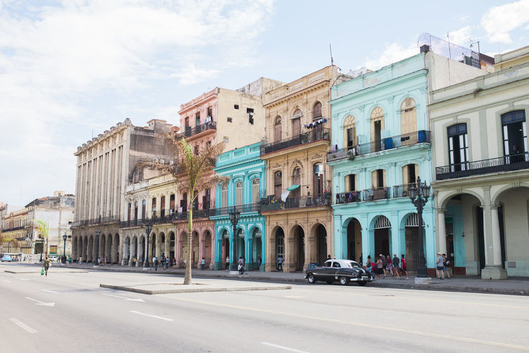 Architecture Blue Building Exterior Built Structure Car City Colorful Colors Cuba Day Fassade Havana History No People Old Car Oldtimer Outdoors Pink Road Sky Vivid Colours  Yellow