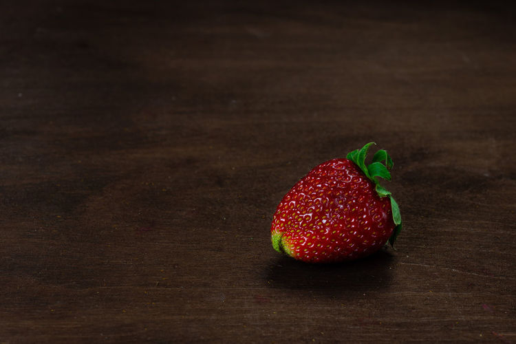 Strawberry on a dark wood background. Creative pattern concept. Food And Drink Food Freshness Red Indoors  Still Life No People Strawberry Strawberries Fruit Fruits Fresh Healthy Eating Vehetable Natural Raw Vitamin Raw Food Tasty Breakfast Ripe Juicy Sweet Berry Delicious Nutrition Background Rustic Dessert Freshness Eating Organic Close-up Diet Ingredient Vegan Snack Apperitive Pattern Dark Wooden Table Brown Texture Textured  Flat Flat Lay Berry Fruit Wellbeing Wood - Material Single Object Copy Space High Angle View