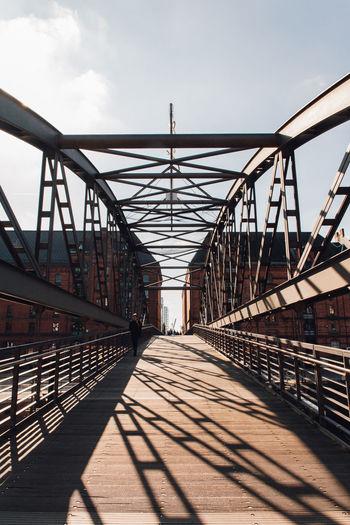 View of footbridge against sky