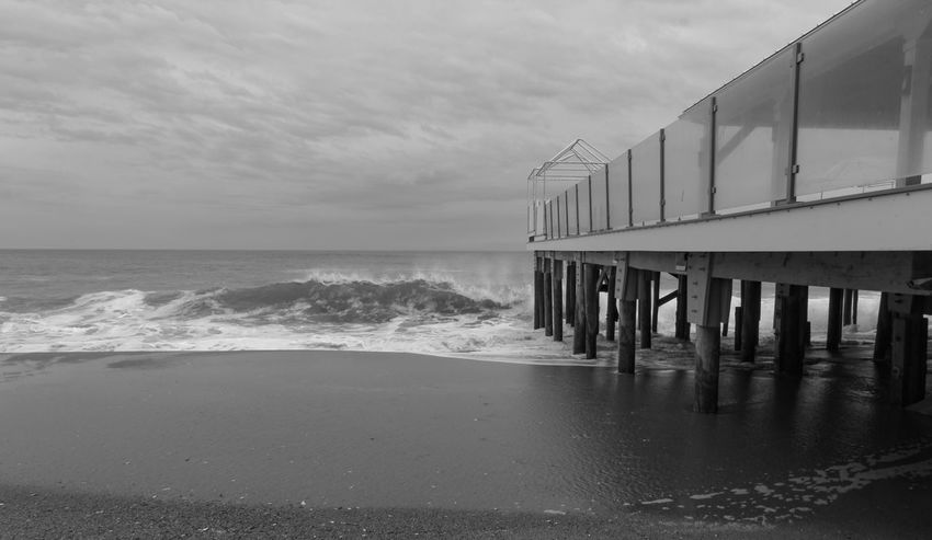 """""""Pier"""" Photographed by AJTinker AjTinkerPhotography Sea Beach Horizon Over Water Water No People Sky Sand Tranquility Wave Outdoors Built Structure Scenics Beauty In Nature Architecture Nature Day EyeEm Gallery EyeEmSelect Tranquil Scene Cloud - Sky EyeEm Best Shots Black And White Black & White"""