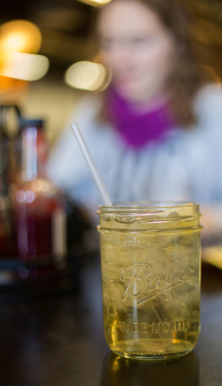 one person, table, jar, indoors, drink, focus on foreground, refreshment, real people, drinking straw, close-up, day, freshness, young adult, people