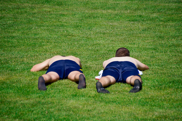 Connected By Travel Lost In The Landscape Boys Childhood Day Field Full Length Grass Green Color Growth Leisure Activity Lying Down Nature Outdoors People Playing Real People Soccer Field Sportplatz Togetherness Two People Be. Ready.