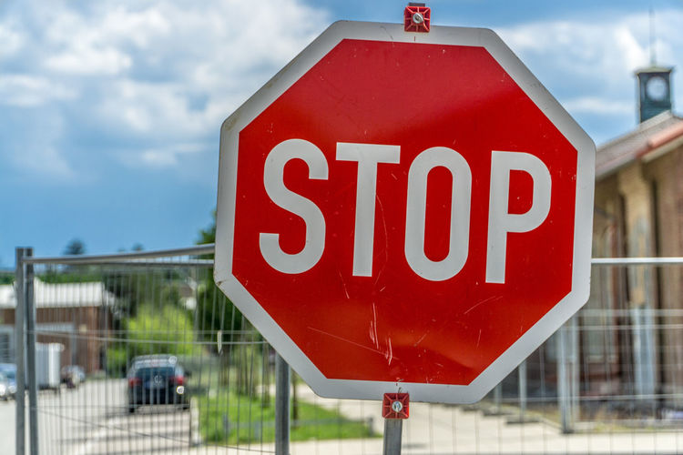 Close-Up Of Stop Sign Against Sky