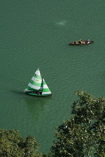 High angle view of boats sailing in sea