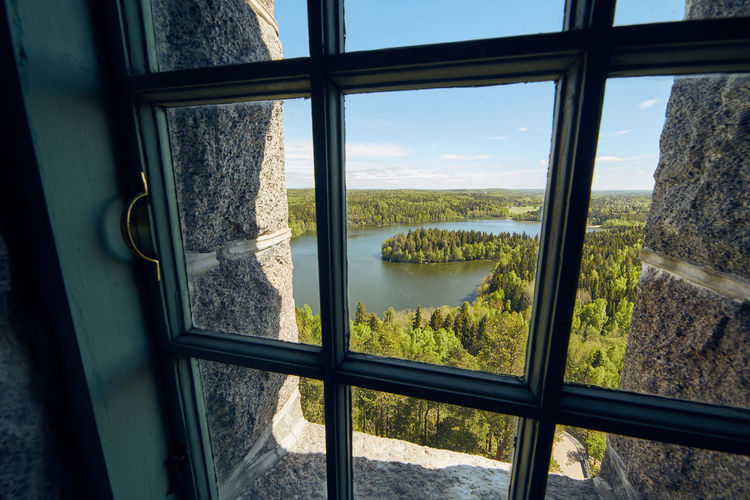 Landscape view through a window at Aulanko lookout tower in Finland. Architecture Aulanko Building Built Structure Day Distant View Finland Hämeenlinna Indoors  Interior Interior Views Interiors Landscape Nature Nature Park  Nature Reserve No People Railing Scenics Tower View View Through The Window Water Window Window View