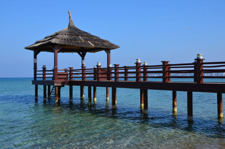 Architecture Blue Clear Sky Day No People Outdoors Pier Sea Sky Summer Tranquility Travel Destinations Vacations Water Wood - Material Holiday Vacation