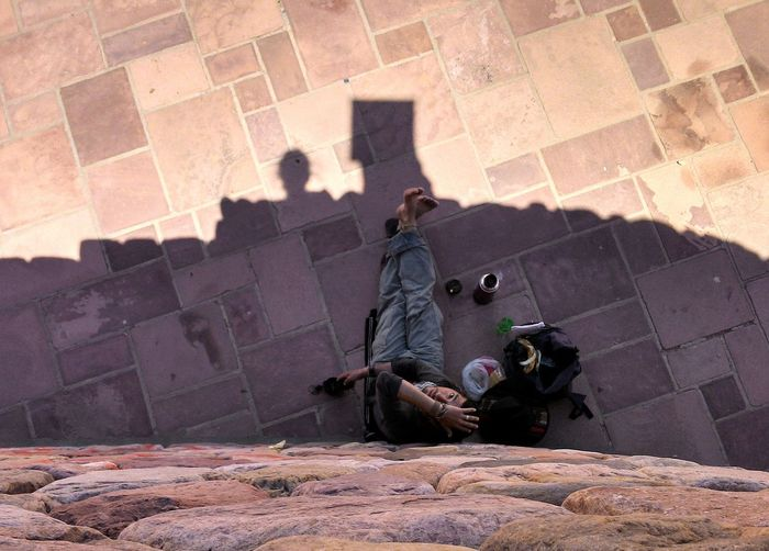 Man sitting on cobblestone