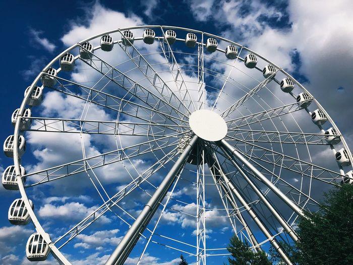 EyeEm Selects Sky Cloud - Sky Low Angle View Ferris Wheel Amusement Park Amusement Park Ride Arts Culture And Entertainment Built Structure No People Outdoors Geometric Shape Architecture Circle Shape Blue Nature