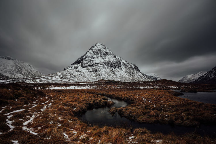 Rannoch moor mountain in scotland wide scenic view with lake and cloudy sky