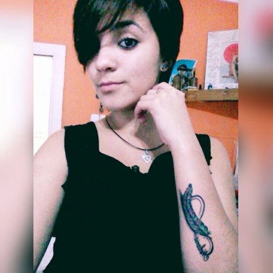 Somos uno Girl Afternoon Shower Black Tattoo Plume Feather  Eagle Seriousness  Light Boring Cute Posing Profile Face