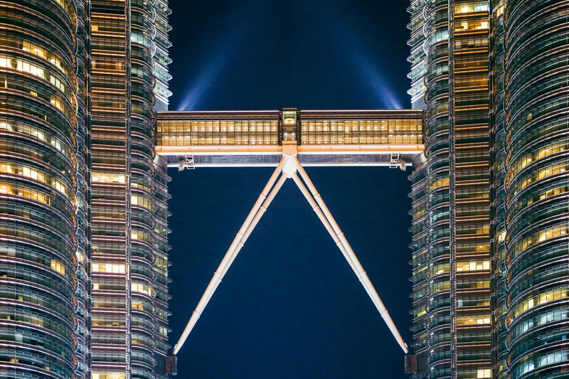 Illuminated petronas towers at night