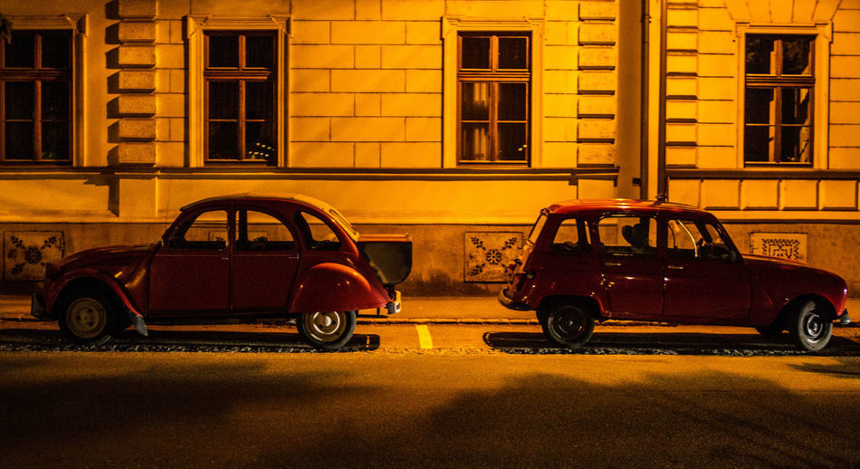 The Meeting Car Portrait Youngtimer Old Classic Car Outdoors Classic Classic Car Nightphotography Architecture Land Vehicle Transportation Building Exterior Yellow No People Citroen 2cv Renault 4 Oldtime The Street Photographer - 2017 EyeEm Awards