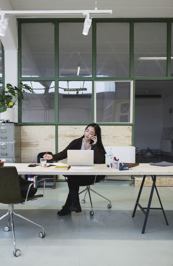 Woman working on table in office