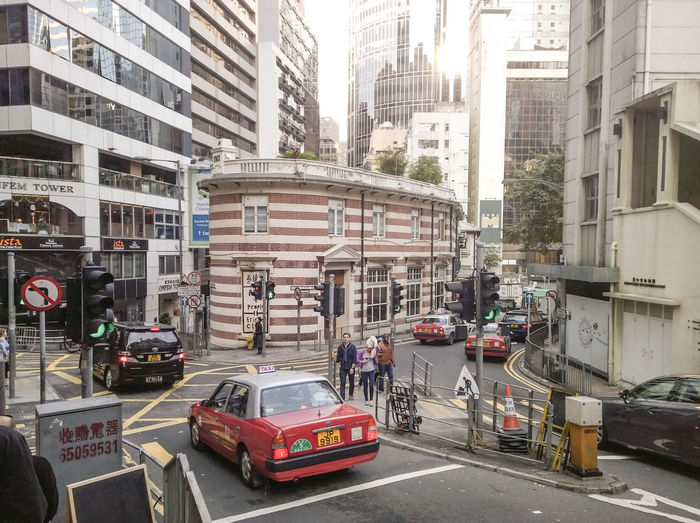 Architecture Building Exterior Built Structure Car City Cityscape Day Hong Kong Island Land Vehicle Modern No People Outdoors Road Skyscraper Street Streetview Taxi Transportation
