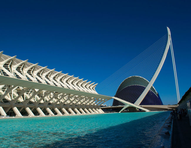 Architecture Blue Building Exterior Built Structure Clear Sky Copy Space Day Low Angle View Modern No People Outdoors Palm Tree Railing Sea Sky Sunlight Swimming Pool Transportation Travel Destinations Water