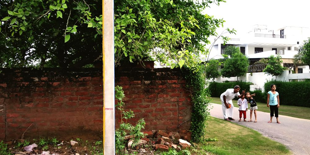 I click a bird which is sitting on the boundary of the wall I met the grate moment of in click grand paa and his grandson and grand_daughters The Street Photographer - 2018 EyeEm Awards Tree Full Length Togetherness Walking Candid Building Exterior Architecture Built Structure Children Mixed Age Range