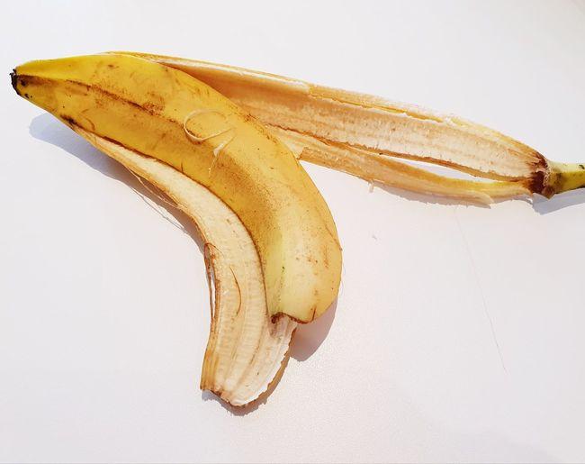 Rest of a banana Marketing Tropical Grow Vitamin B Food Delicious Savour Musaceae Taste Slip On A Banana Peel Eaten Rest Slip Slippery Zoom Tasty Vitamins Healthy White Background Banana Peel Fruit Yellow Banana Eaten Close-up Food And Drink Peel Tropical Fruit Peeled Peeling Off