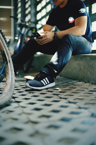Out Of The Box Sitting One Person Real People Men Bicycle Transportation Lifestyles Day Young Adult Wireless Technology Low Section One Young Man Only Technology Indoors  One Man Only Close-up Adult People Adults Only Adidas Sneakers Out Of The Box Investing In Quality Of Life