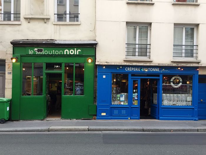 A Green house that's called black sheep and a Blue Crêpes Restaurant . French people are funny.