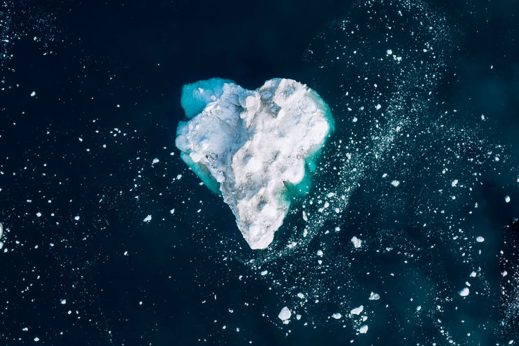 No People Nature Water Studio Shot Underwater Sea Cold Temperature Blue Outdoors UnderSea Close-up White Color Sky Mid-air Astronomy Motion Heart Shape Snow Black Background Marine Purity Ice Shape Text Iceberg