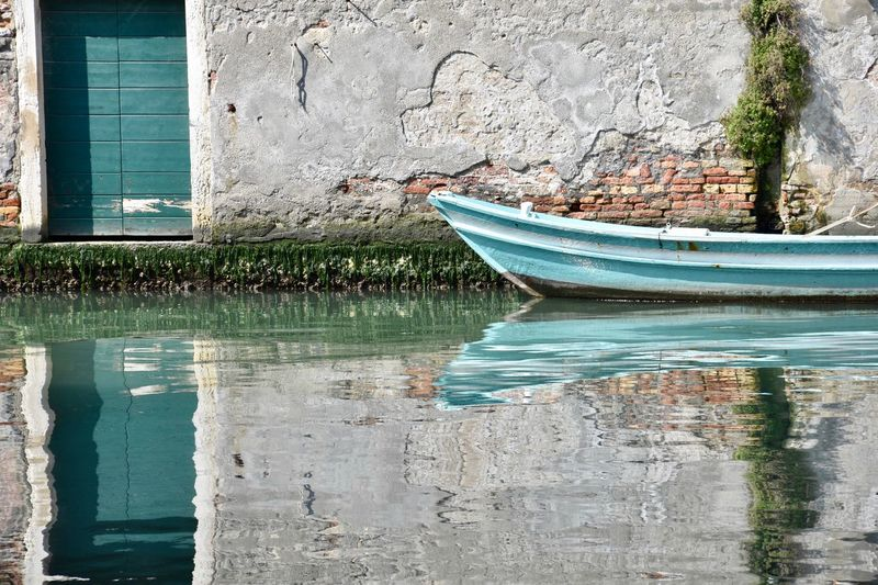 Boat moored in venice against wall