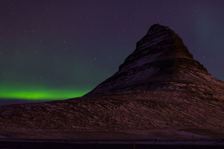 Northern lights behind Kirkjufell mountain, pt. 1 Night Sky Astronomy Star - Space Aurora Borealis Northern Lights Environment Beauty In Nature Scenics - Nature Mountain Iceland Kirkjufell