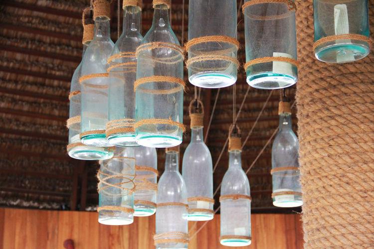 Bottle Glass - Material No People Transparent Indoors  Close-up Glass Decoration Restaurant Decor Ceiling Art Ceiling Design Glass Bottle Ceiling Decorations Ceiling Decor Handmade