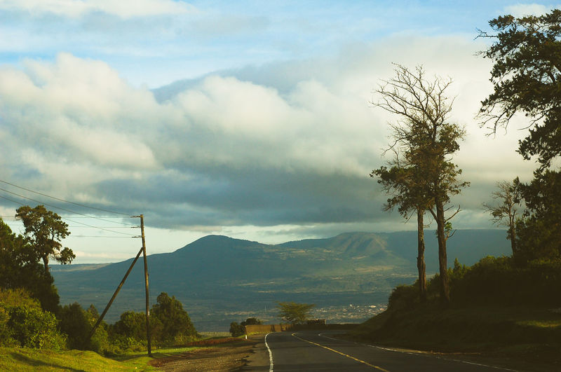 Entering the great rift valley. Sky Tree Road Cloud - Sky Plant Transportation Nature Beauty In Nature Mountain Direction The Way Forward No People Sign Marking Day Scenics - Nature Symbol Road Marking Landscape Environment Electricity  Outdoors Crash Barrier