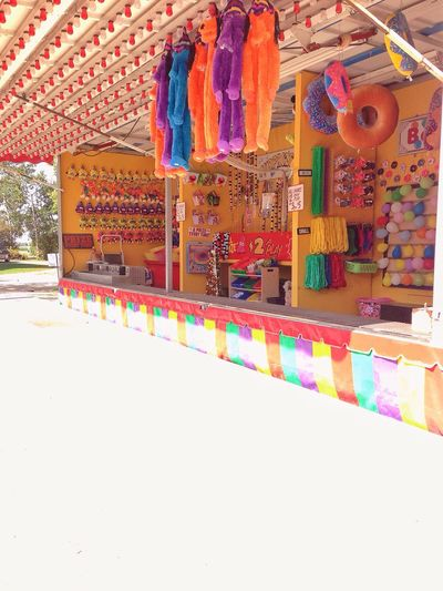The Week On EyeEm Multi Colored No People Day Carnival Games Prizes Pay To Play At The Fair Carnival Amusement Park Outdoors Fun