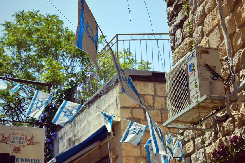 Architecture Blue Building Exterior Built Structure Country Flags Day Flags Hanging Israel Low Angle View No People Outdoors Sky Street Tree Tzfat