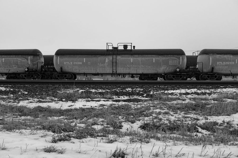 what the oil and gas industry feels like right now Bakken Blackandwhite Cold Temperature Frozen NoDak Oil Oil And Gas Outdoors Perspective Rail Railroad Track Railway Track Straight Tanker Train Winter