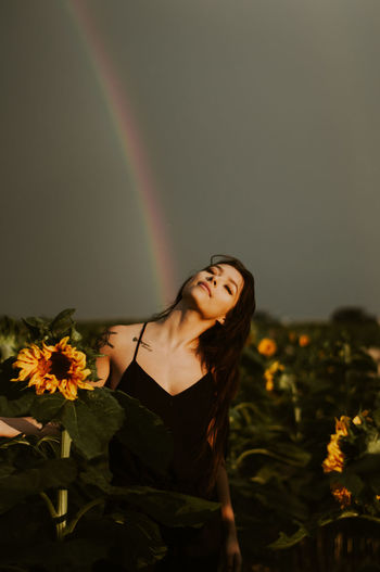 Young Women Young Adult Leisure Activity Beauty Real People Plant Nature Women Lifestyles Beautiful Woman Flowering Plant Flower Beauty In Nature Rainbow Sunflower Summer Direct Light Rain Summertime Yellow Sunlight Happy Happiness One Person Hair