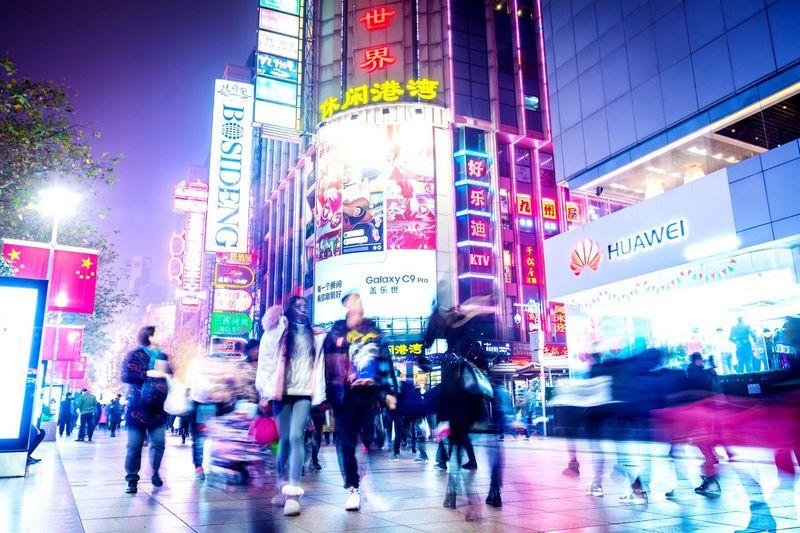 The Street Photographer - 2017 EyeEm Awards Motion Neon Shanghai China Real People