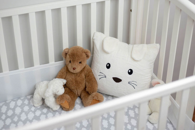White crib with stuffed toys - gray and white gender neutral baby's room Baby's Room Neutral Colors Nursery Soft Bedding Bedroom Cozy Crib Cute Gender Neutral Getting Ready For Baby Gray Gray And White Indoors  Infant Stuffed Animals Stuffed Toy Teddy Bear Toy White Color