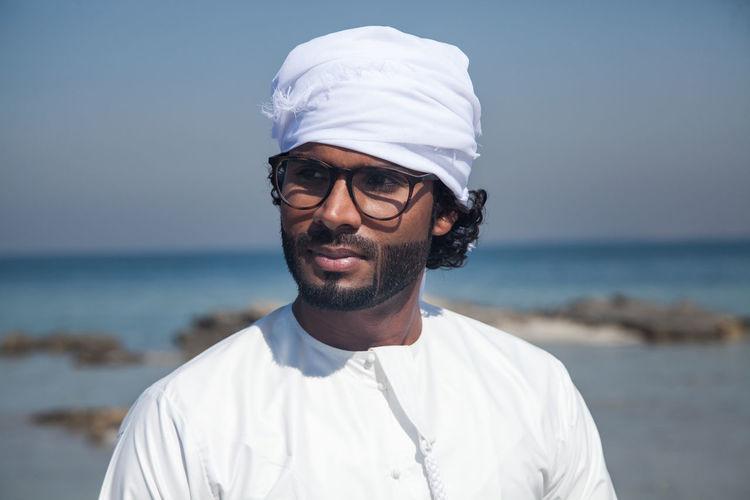 Portrait of man wearing turban on beach