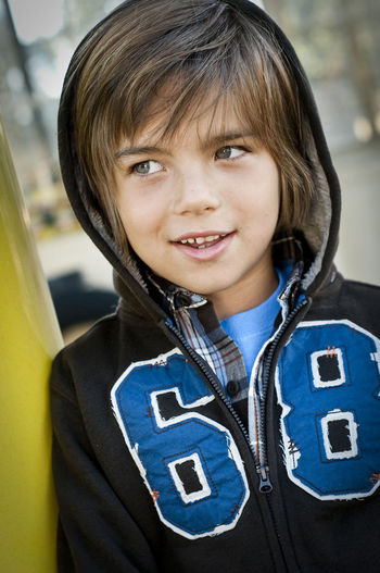 Cute expression Portrait Childhood Child One Person Front View Close-up Day Emotion Focus On Foreground Headshot Looking Away From Camera Hood - Clothing Number Sweat Shirt Boy Kid Young Glance Eyes Expression