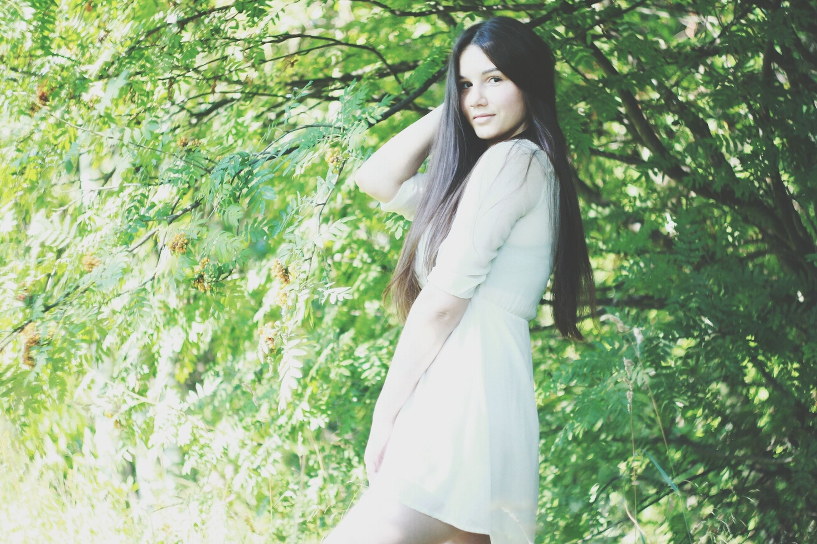 young adult, young women, person, casual clothing, lifestyles, front view, standing, looking at camera, tree, portrait, leisure activity, three quarter length, long hair, smiling, beauty, fashion, dress