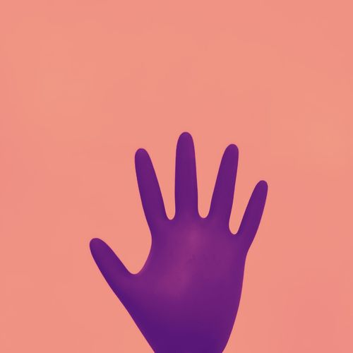 Close-up of hand against red background