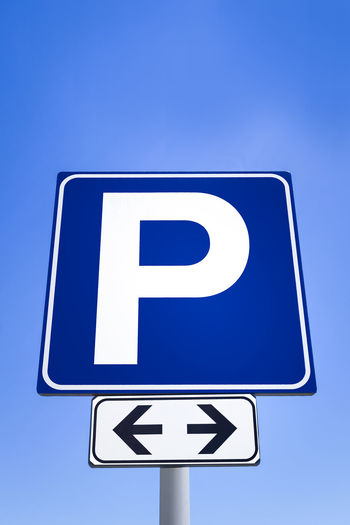 Free parking signal, for both street sides, with the blue sky in the background. City Free Icon Isolated Road Rules Service Sign Signal Traffic Transport Transportation Background Blue Information Metal Metallic Nobody Object Outdoor Parking Sky Steel Symbol Urban