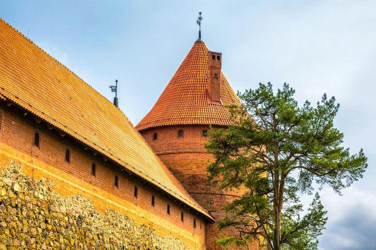 Low angle view of trakai island castle against sky