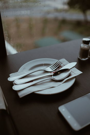 High angle view of silverware on plate at table