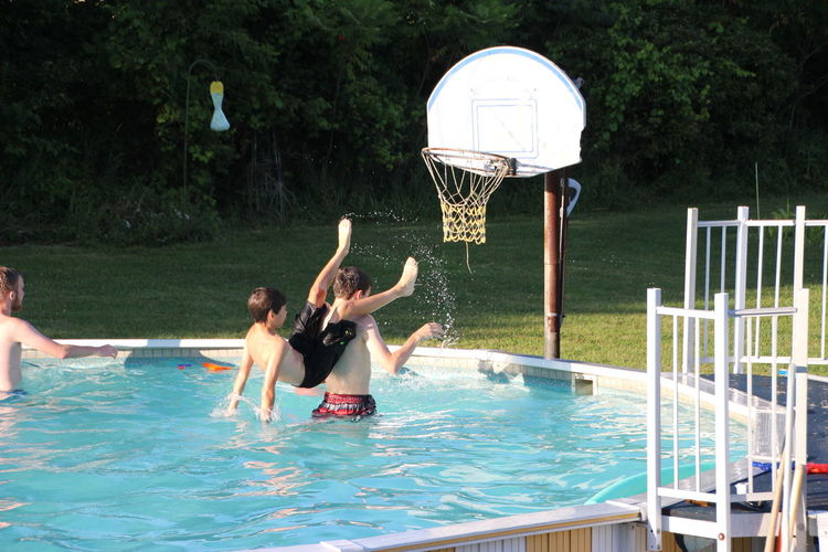 fun in the pool never gets old Summer Fun Basketball - Sport Day Falling In Water Fun Leisure Activity Outdoors People Playing Pool Real People Shirtless Swimming Pool Water