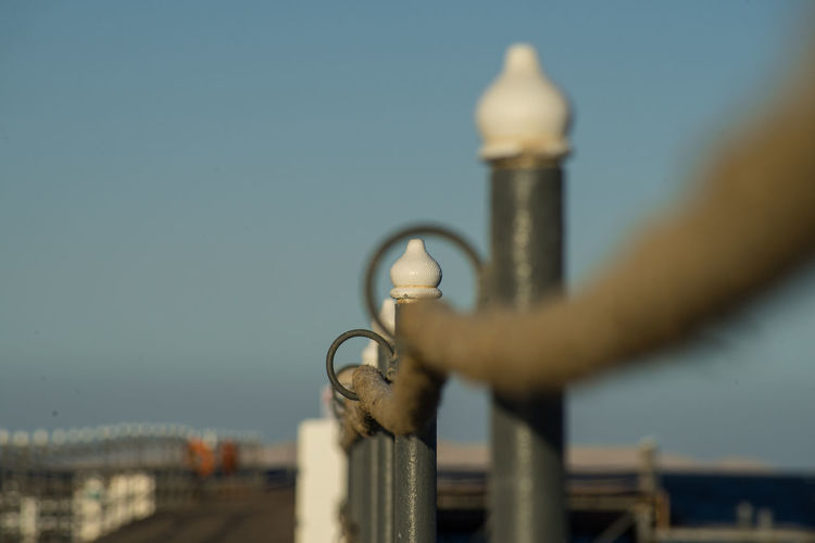 Rope railing with eyelet of a landing stage in the evening light. close-up. scene from egypt.
