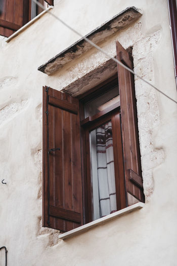 Architecture Building Building Exterior Built Structure City Closed Day Door Entrance House Low Angle View No People Outdoors Residential District Snow Wall Wall - Building Feature Window Window Frame Winter Wood - Material