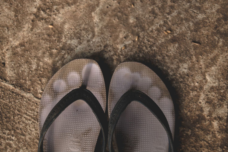 Slippers Foot Wear Sandals Pair Shoe Leg Toe Flat Shoe Textured  Sandal Flip-flop Rough Rugged Shoelace Footwear Things That Go Together Low Section 10 The Still Life Photographer - 2018 EyeEm Awards The Traveler - 2018 EyeEm Awards The Photojournalist - 2018 EyeEm Awards The Fashion Photographer - 2018 EyeEm Awards
