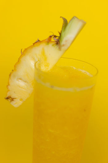 Yellow pineapple smoothie with fresh pineapple on glass with yellow background,healthy detox or diet concept Food And Drink Yellow Food Freshness Fruit Healthy Eating Close-up Indoors  Glass Drink Refreshment Wellbeing No People Drinking Glass Still Life Studio Shot SLICE Colored Background Alcohol Household Equipment Cocktail Ripe