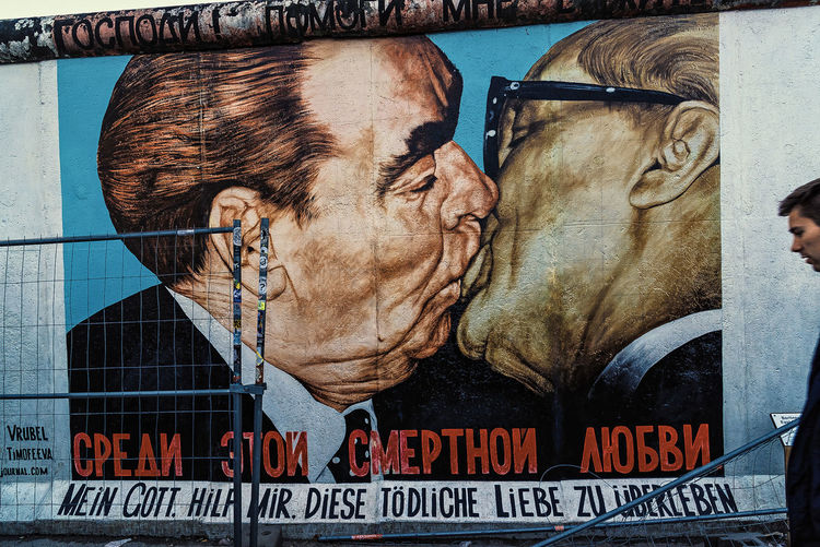 Leonid Brezhnev and Erich Honecker's kiss pictured on the Berlin Wall in East Side Gallery in Berlin, Germany Adult Adults Only Archival Berlin Berlin Wall Day East Side Gallery Erich Honecker Erich Honecker's Human Body Part Kiss Leonid Brezhnev Men Outdoors People