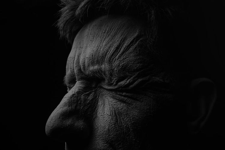 Black Background Close-up Headshot Human Body Part Indoors  Lifestyles Men Night One Person People Real People Rear View Studio Shot Women Wrinkled Skin